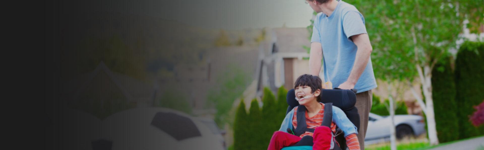 caregiver assisting a boy