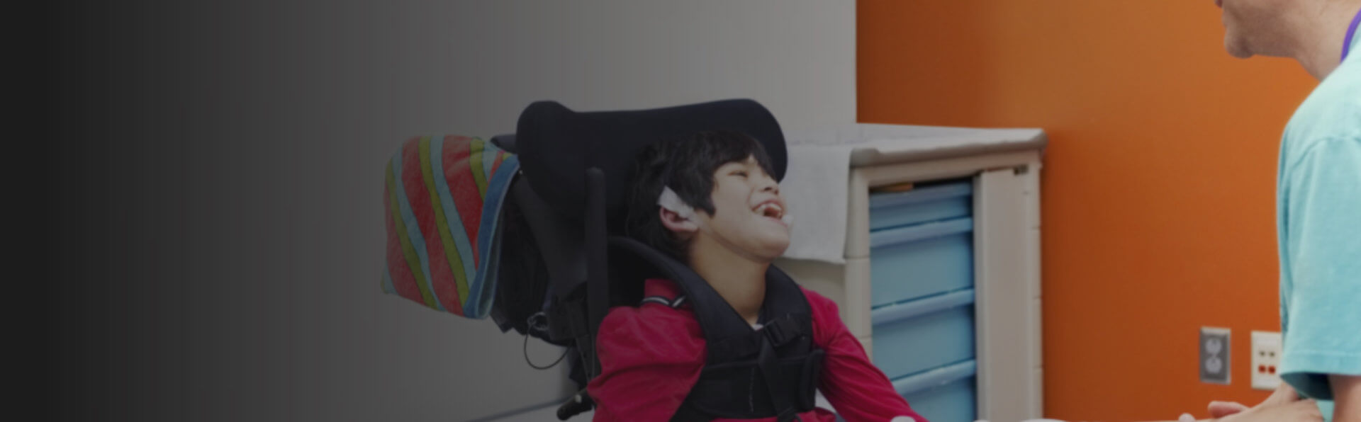 little boy showing a happy face despite of his condition