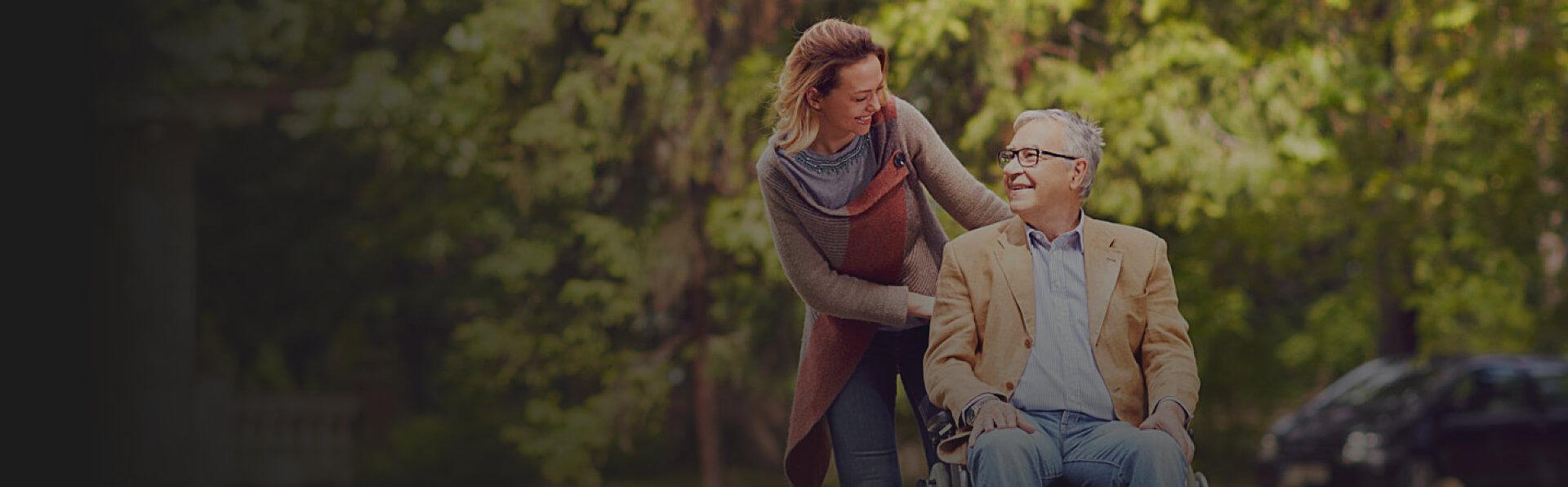 caregiver assisting old man