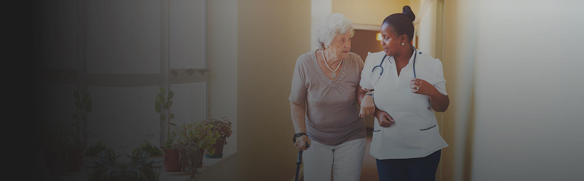 caregiver and old woman enjoying each others company