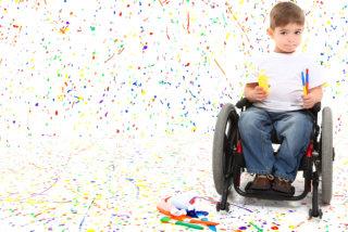 A cute boy riding his wheelchair